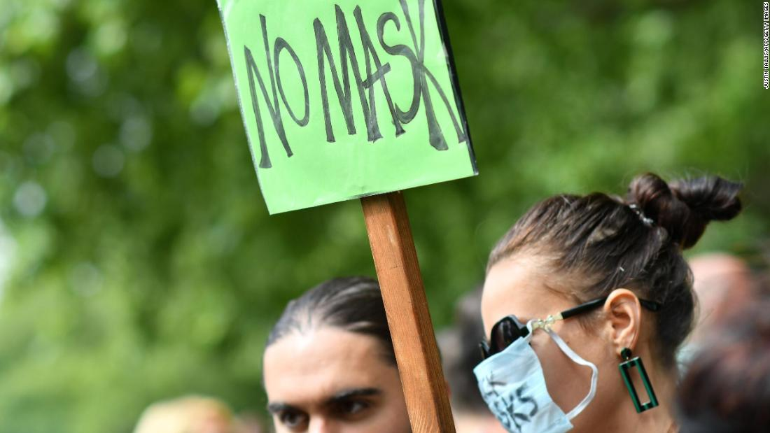 A protester holds up a placard at the London rally on Sunday.