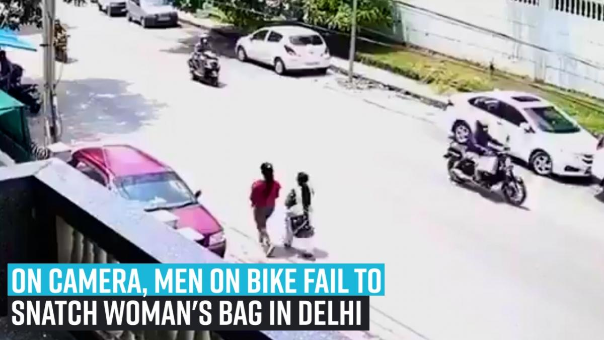 On camera, men on bike fail to snatch woman