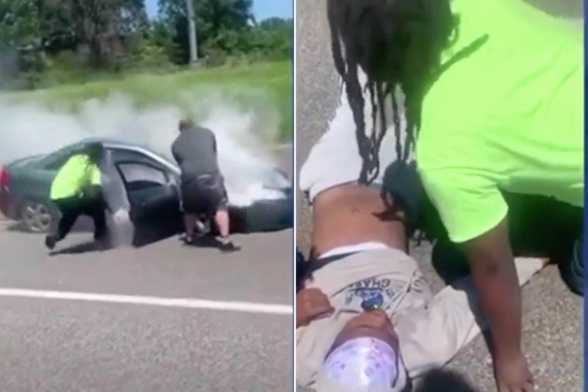 Heroïsche vreemdeling haalt chauffeur uit vlammende auto in dramatische video