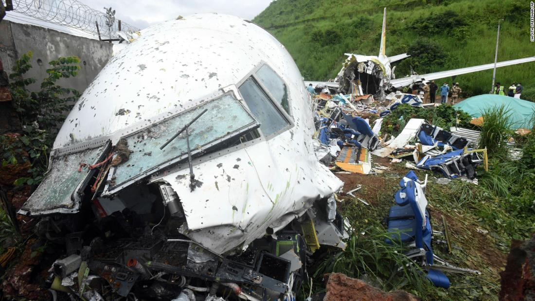 A man walks near the wreckage of the Air India Express plane on Saturday.