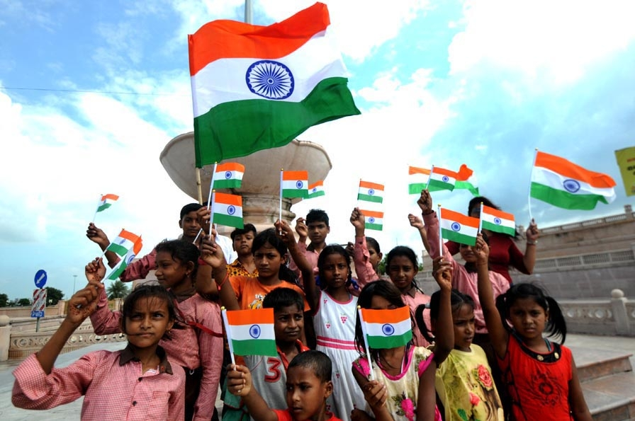 Lucknow: Children holding National Flags celebrate Independence Day, in Lucknow on Aug 14, 2019.